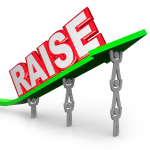 The word Raise on an arrow lifted by workers who are asking for